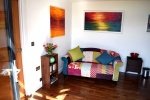 The lounge area with colourful paintings