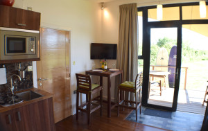 Gallery Lodges kitchen and dining area with 32 inch TV